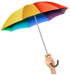 Hand with a rainbow umbrella vector image