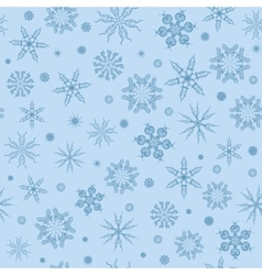 white snowflakes on a blue background vector image