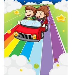 Two kids riding in a red car vector image