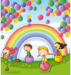Kids playing with floating balloons and rainbow in vector image