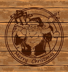 Santa Claus on a wooden boards vector image