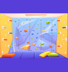 rock climbing wall with grips mats and ropes vector image