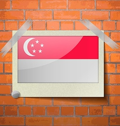 Flags Singapore scotch taped to a red brick wall vector