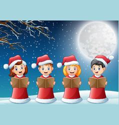 Kids in red santa costume singing christmas carols vector