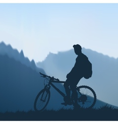 Cyclist in mountains vector