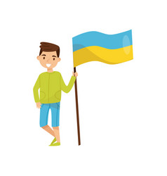 boy holding national flag of ukraine design vector image