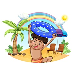 A young boy enjoying at the beach vector image