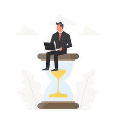 businessman with laptop sits on a big hourglass vector image