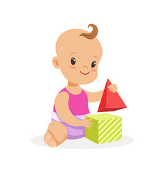 Sweet smiling baby sitting and playing with toy vector