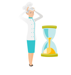 Worried senior caucasian chef looking at hourglass vector