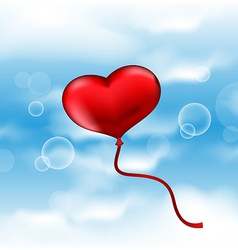 Balloon in the shape of heart on blue sky vector image