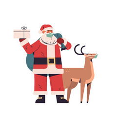 Santa claus with reindeer in protective masks vector