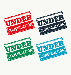 Under construction sign in four colors vector