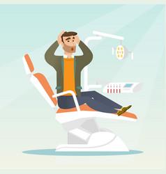 Afraid man sitting in the dental chair vector