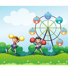 Two cheerers dancing in the hill with a ferris vector image