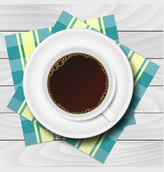 Cup of coffee with checkered napkins on white vector