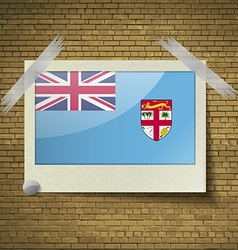 Flags Fiji at frame on a brick background vector image