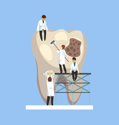 Small male doctors treating caries hole on giant vector