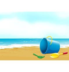 A bucket fork and shovel at beach vector