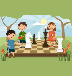 young children playing a game chess outdoors vector image