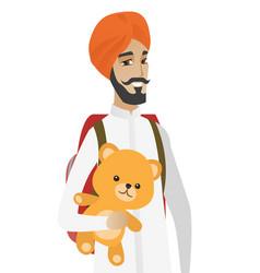 Hindu traveler man holding teddy bear vector