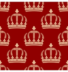 Seamless pattern of crowns on a red background vector
