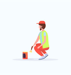 man cleaner in uniform using paintbrush and paint vector image