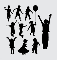 Kid playing silhouettes vector
