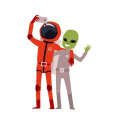 Cartoon astronaut and green alien taking selfie vector