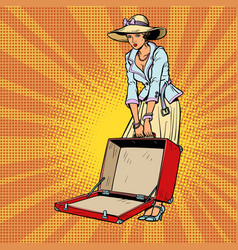 woman with open suitcase vector image