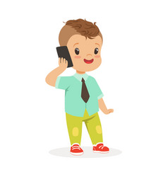 Cute little boy standing and talking on mobile vector
