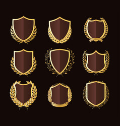 Golden shields laurel wreaths badges collection vector