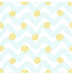Grunge chevron and polka dots seamless pattern vector
