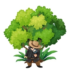 A detective near the big tree vector