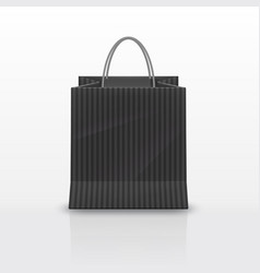 Realistic black paper shopping bag with handles vector