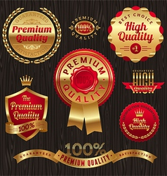 set golden quality labels and emblems vector image