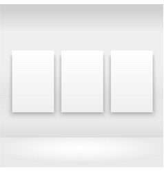 Empty frames on the wall in gallery with lights vector