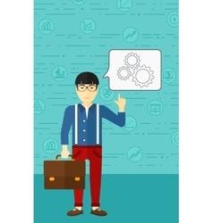 Businessman pointing at cogwheels vector image