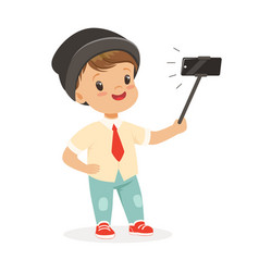 Cute little boy in fashionable clothes taking vector