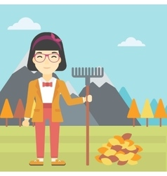 Woman raking autumn leaves vector image