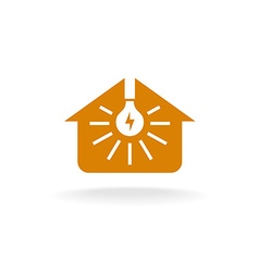 Light bulb with rays inside of a house silhouette vector image
