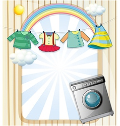 A washing machine with hanging clothes at the top vector