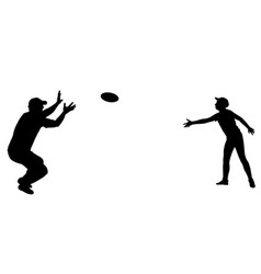 father and son playing frisbee silhouette vector image