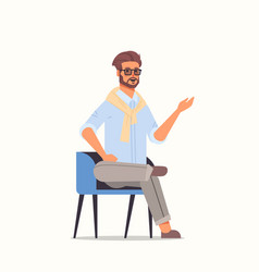 businessman sitting on armchair pointing away vector image