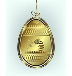 Golden Easter egg with a bow vector image