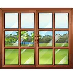 A closed wooden window with glass vector