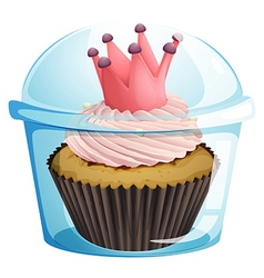 A cupcake with a crown inside the disposable vector