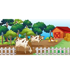 A farm with animals inside fence vector