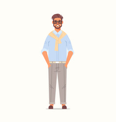 Businessman standing with hands in pockets vector
