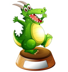 A smiling green dragon above empty label vector